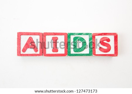 Wood blocks spelling out aids on white background