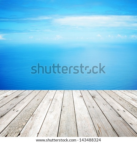 Wood, blue sea and sky background - stock photo
