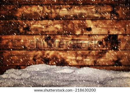 Wood board and mound of snow. Snowing blizzard. Vintage retro style. Merry Christmas! - stock photo