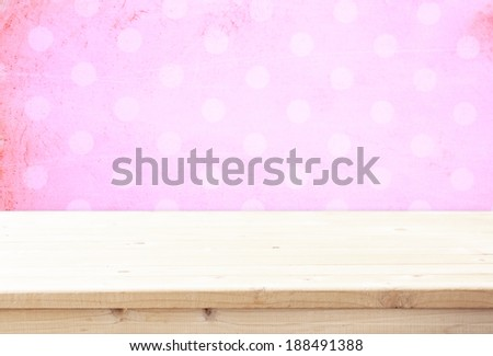 wood board and pink vintage background for product display - stock photo