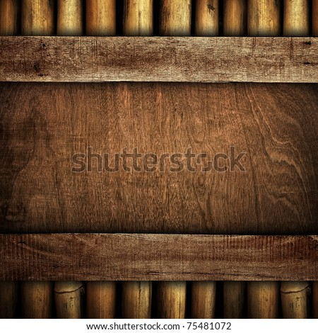 wood board with bamboo frame - stock photo