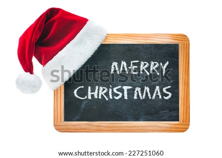 Wood board with Santa hat isolated on white background