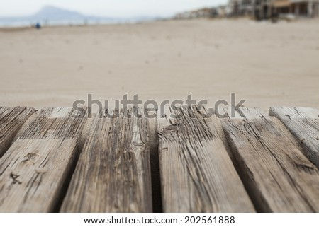Wood boardwalk on the beach - stock photo