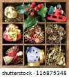 Wood box with old decoration items for Christmas tree - stock photo