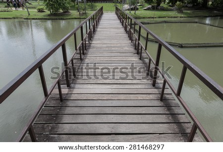 wood bridge in lake