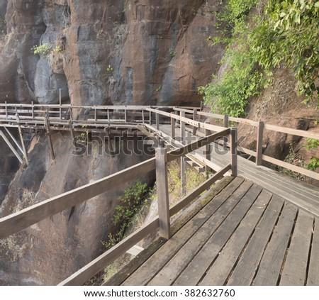 wood bridge in the stone - stock photo