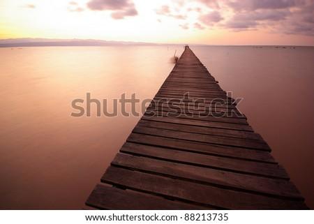wood bridge on sea - stock photo
