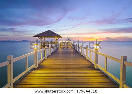 Wood bridge with seascape at twilight time. - stock photo
