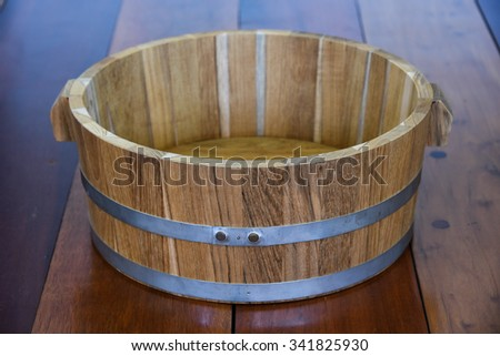 wood bucket on wooden floor background - stock photo