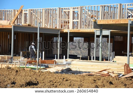 Wood building framing with steel columns and steel beams - stock photo