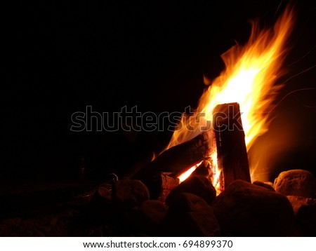 Wood Burning Fire In The Photo Are Flames Of Campfire