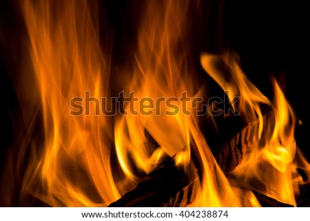 wood burning in a fire isolated on a black background - stock photo