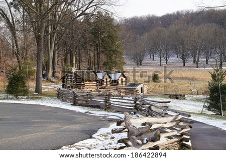 Wood cabins surrounded by trees in winter. - stock photo