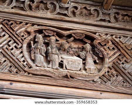 Wood Carving Chinese historic story on outside door.