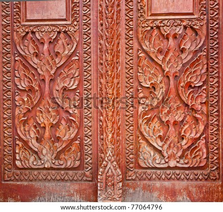 wood carving decorated at windows of the temple tells story about Lord Buddha, hand made by Thai artisan, Khonkaen,Thailand - stock photo