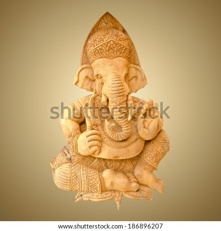 Wood carving of Ganesha isolated on gradient brown background with working path