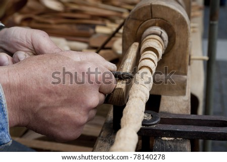 wood carving process with metal chisel - stock photo