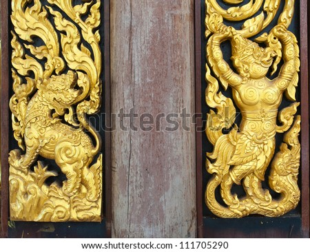 Wood carvings (art on temple wall,Thailand.Gener ality in Thailand, any kind of art decorated in Buddhist church etc. created with money donated by people, no restrict in copy or use) - stock photo