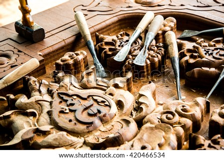 wood carvings, tools and processes - stock photo