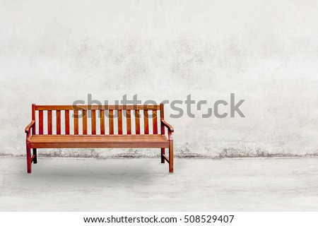 wood chair on Aged street concrete wall texture