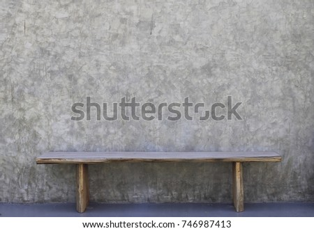 Wood chair with raw concrete