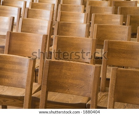 Wood chairs in a row - stock photo
