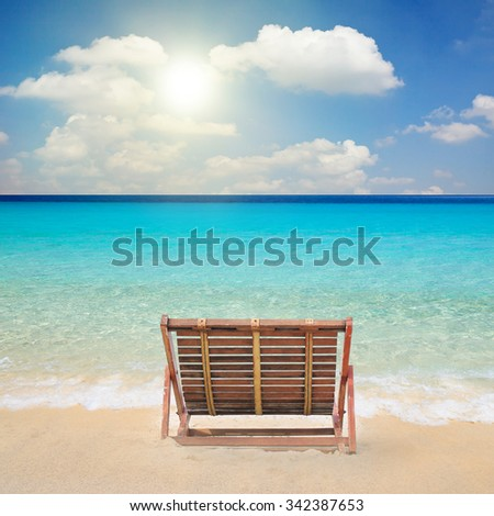 Wood chairs on the beach.
