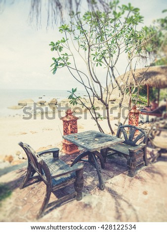 wood chairs on tropical beach (Vintage filter effect used) - stock photo