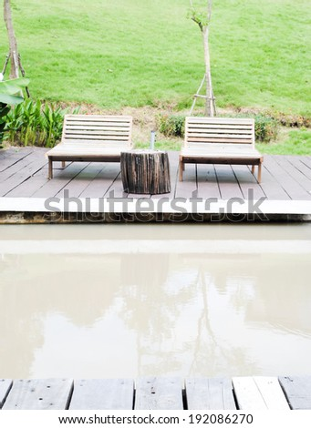 wood chairs with table - stock photo