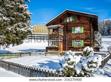 Wood chalet in winter resort Davos, Switzerland. - stock photo