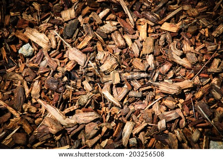 Wood chips for landscaping in the gardens. Ecological background. Vignette toning. - stock photo