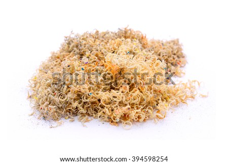 Wood chips from the pencil sharpener on white background - stock photo