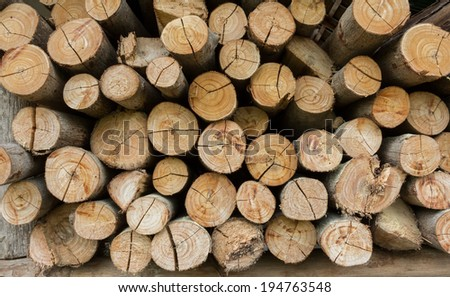 Wood chopped firewood stacked on the stack. Natural background  - stock photo