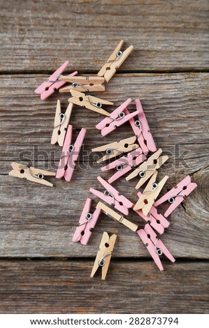 Wood clothespins on grey wooden background - stock photo