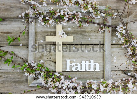 Wood Cross And The Word Faith Hanging On Antique Rustic Wooden Background With White