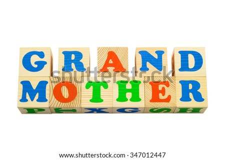 Wood cube with inscription GRANDMOTHER isolated on a white background