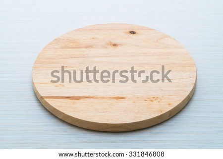 Wood cutting board on wooden textures background