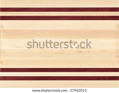 Wood cutting board with different color wood strips. - stock photo
