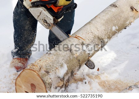 Wood cutting with a chainsaw