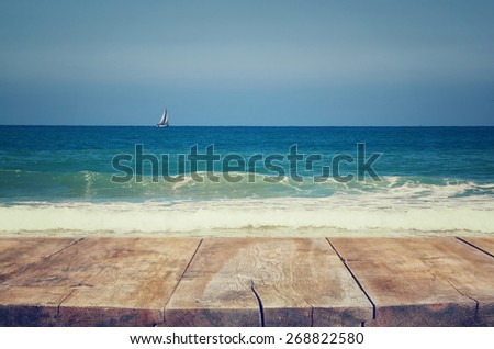 wood deck in front of sea landscape. ready for product display. textured image  - stock photo