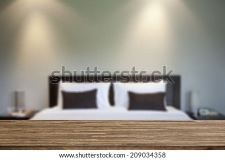 Wood desk decoration with bedroom background - stock photo