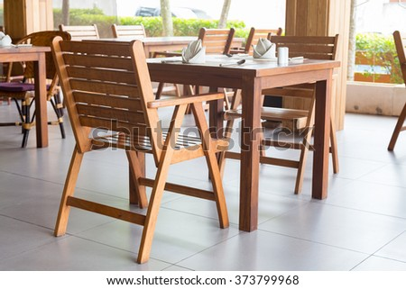 Wood dining table for food preparation equipment is ready. - stock photo