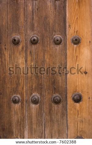 wood door detail in vertical view - stock photo