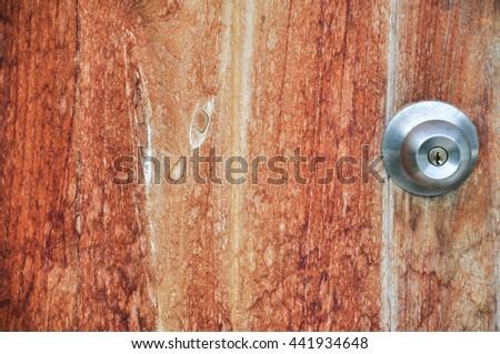 wood door with metal door handle & Peephole On Wooden Door Judas Hole Stock Photo 84964399 - Shutterstock Pezcame.Com