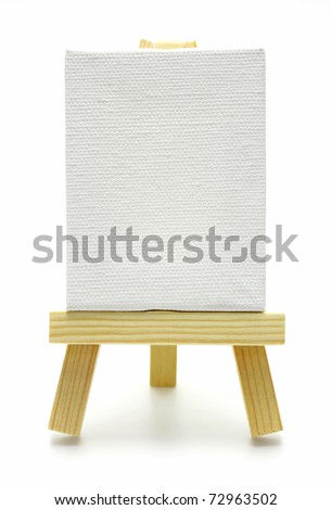 wood easel with white canvas isolated - stock photo