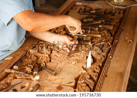 wood engraver at work for woodcut.  - stock photo