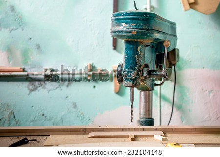 wood factory with industrial drilling and milling tool. Old furniture factory with vintage tools - stock photo