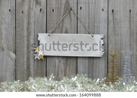 Wood fence with snow garland border and blank sign - stock photo