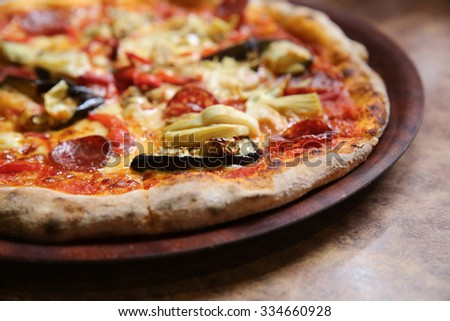 Wood fired eggplant artichoke salami pizza - stock photo