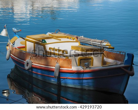 Wood Fishing Boat Floating on the Water/Boat on the Water
